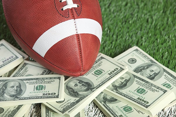 Money, football field and football