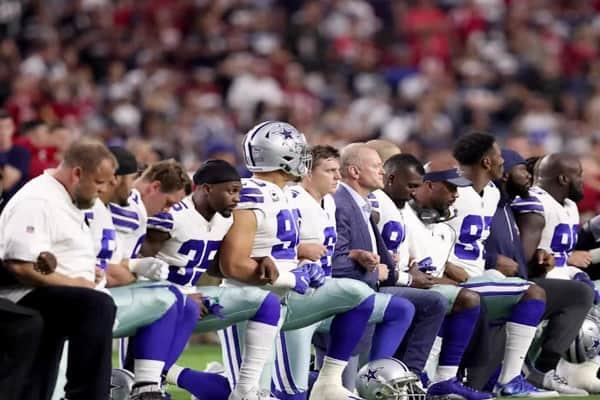 Dallas Cowboys players kneeling