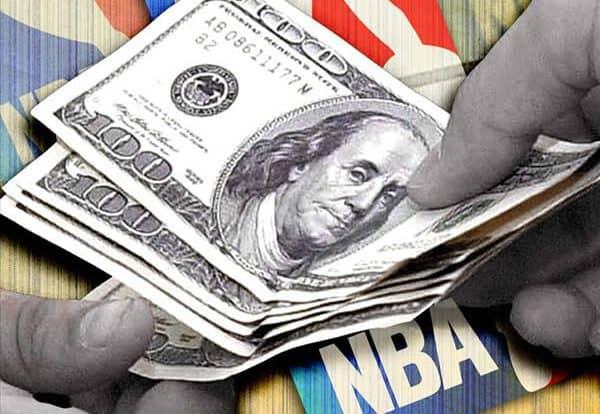 $100 bills over sports logos