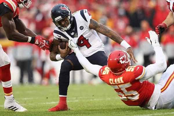 Deshaun Watson getting tackled by a Chiefs player