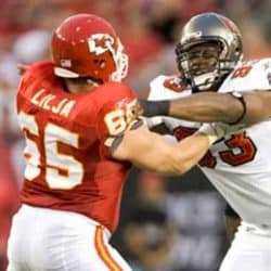 Kansas City Chiefs player battling a Tampa Bay player