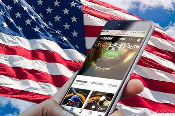 Mobile Sports Betting on a smartphone in front of a US Flag